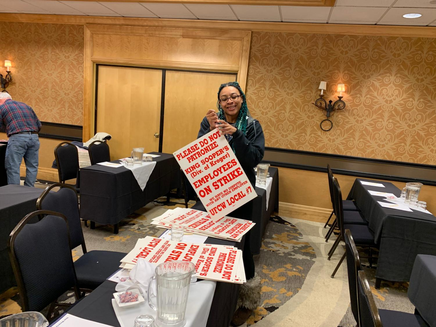 In preparation of a strike, union representatives prepare their picket signs.