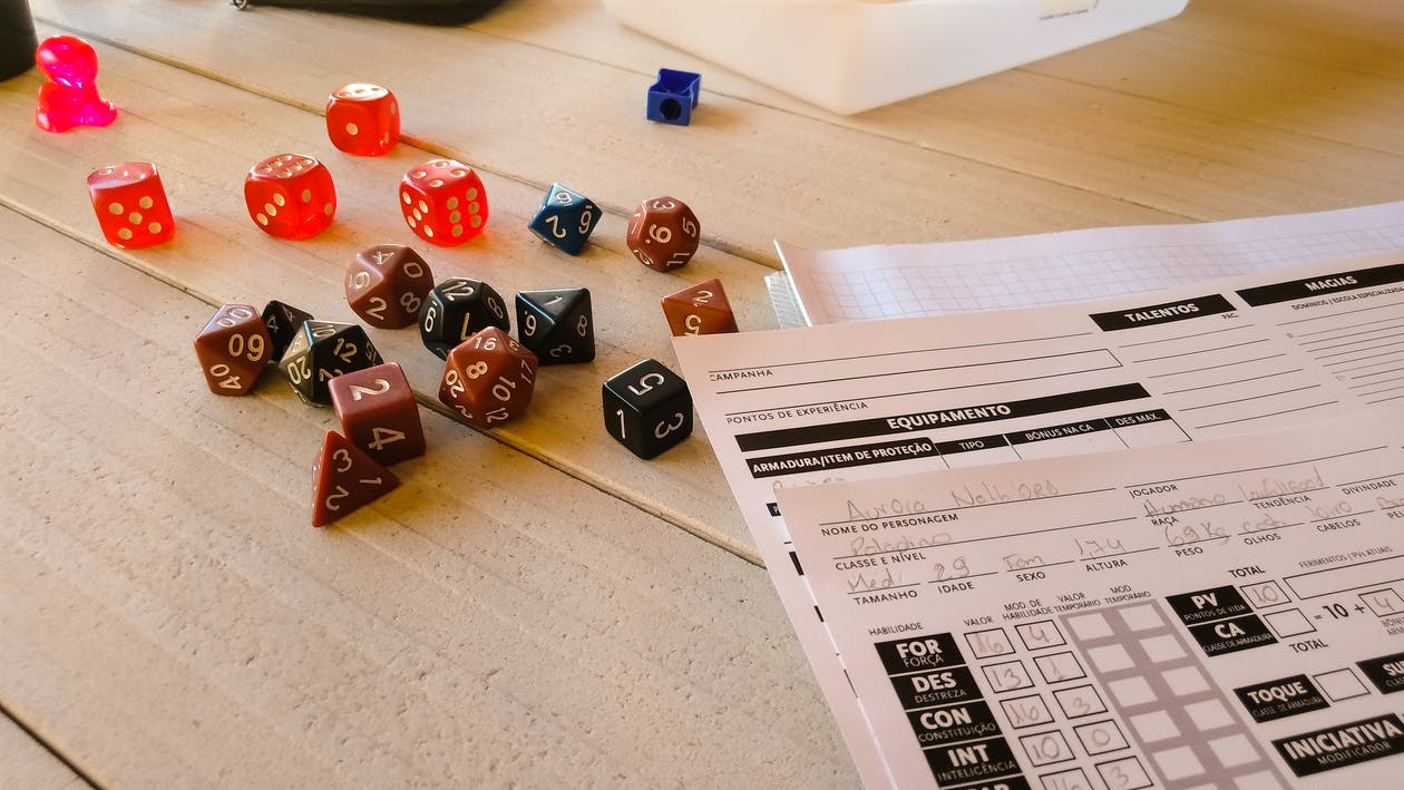 D&D players create characters by rolling dice and choosing attributes through the Player's Handbook. The Game Master, most commonly called the Dungeon Master, writes the story these characters will interact with.  Photo credit: Pexels