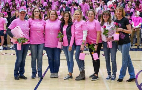 8 lovely ad strong women were recognized at half time for their battles and victories against Breast Cancer.
