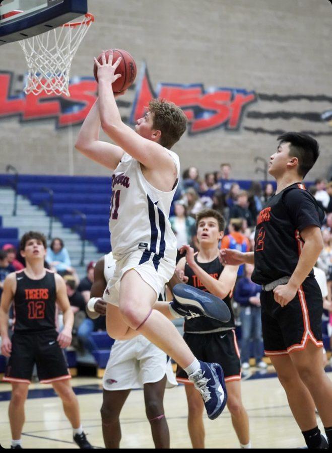 Brayden Rhoades scores for Dakota Ridge High School.