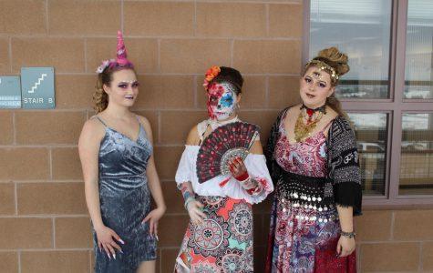 Junior Sophia Tavanello, Kaya Robinson, and Jolie Gastineau prepare themselves to be judged.