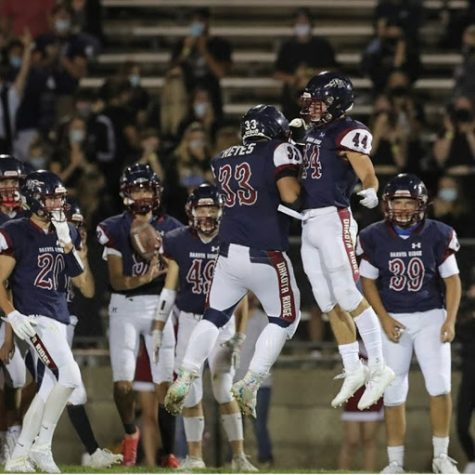 Steve Reyes(12) and Charlie Offerdahl (12) celebrate after another touchdown by Offerdahl.