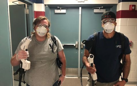 Custodians Sam Faus III (left) and Beau Dorval (right) show off their tools to disinfect the school