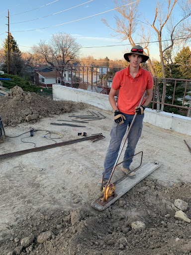 Dakota Ridge junior Milos Jankovic, in the process of constructing his and his father's two story office building.