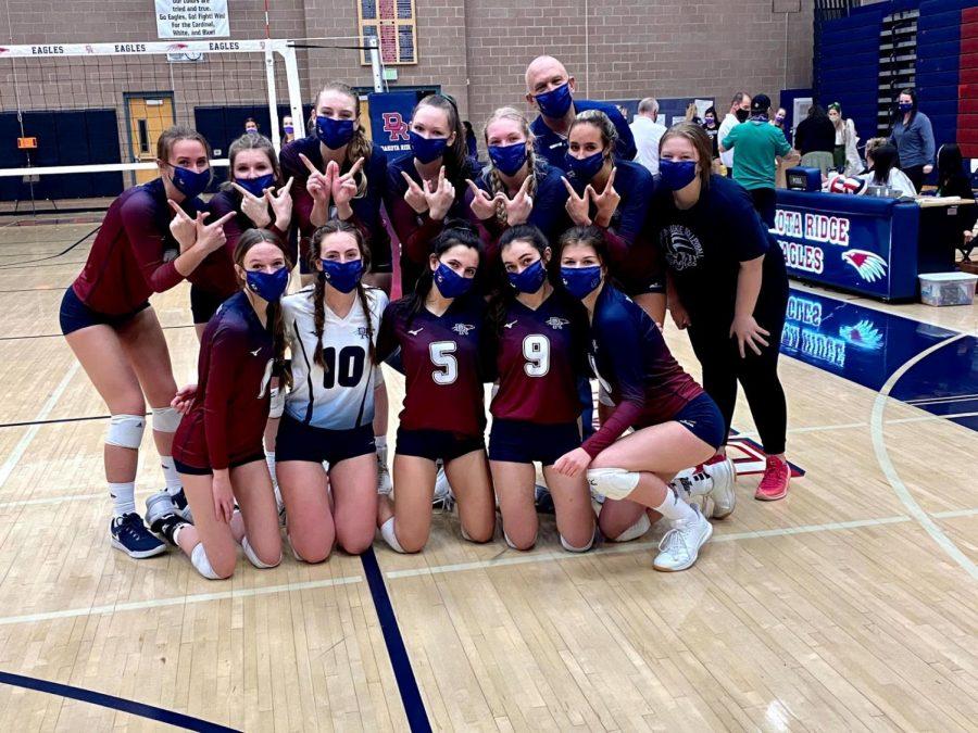 Dakota Ridge Varsity Volleyball team after winning 3-2 against Denver South.