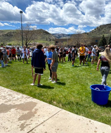 On their last day at DRHS, seniors throw water balloons at younger students.