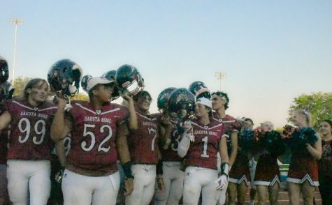 Dakota Ridge comes together after the win against Rampart to sing the Dakota Ridge song.