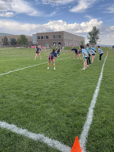 Two competitive powderpuff teams get ready to go through their plays.  The softball team won.